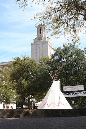 Native American dwelling (foreground) with UT Austin Tower (background)